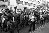 Health workers protest for higher pay against the wage restraint policy of the Heath government, London 1973 - NLA - 1970s,1973,activist,activists,against,BAME,BAMEs,banner,banners,Black,Black and White,BME,bmes,CAMPAIGNING,CAMPAIGNS,cities,City,COHSE,DEMONSTRATING,Demonstration,diversity,EARNINGS,ethnic,ethnicity,F