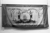 An early trade union banner, from 1838, The friendly Sawyers in Whitehaven, for workers with saws, at trade union banner exhibition in London, 1973 - NLA - 25-04-1973