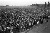 Mass meeting of workers at Perkins Engines, Peterborough, 1973, during pay strike for parity with Massey Ferguson (a sister company in Coventry) - NLA - 1970s,1973,AUEW,company,disputes,ENGINE,Engines,Industrial dispute,male,man,Mass,mass meeting,meeting,MEETINGS,member,member members,members,men,people,Perkins Engines,person,persons,sister,SISTERS,st