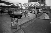 Petrol station closed to the general public during the oil crisis, London, 1973 Police and accounts only - NLA - 1970s,1973,AUTO,AUTOMOBILE,AUTOMOBILES,AUTOMOTIVE,car,cars,cities,City,closed,closing,closure,closures,crisis,EBF,Economic,Economy,lack of,London,no,no petrol,oil,Oil crisis,Oil Industry,petrochemical