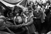 London, 1973, Margo MacDonald Scottish National Party (SNP) arriving at Westminster to take up her seat as the newly elected MP for Glasgow Govan, previously a safe Labour seat - NLA - 1970s,1973,ARRIVAL,arrivals,arrive,arrived,arrives,arriving,cities,City,FEMALE,FLAG,flags,Glasgow,Glasgow Govan,London,Margo Macdonald,new MP,Party,people,person,persons,POL,political,POLITICIAN,POLIT