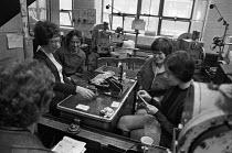 Lucas Aerospace, Birmingham, 1974 Workers occupy factory against redundancies. Women playing cards on the shopfloor - NLA - 28-03-1974