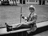 Actor Larry Hagman as J R Ewing promoting the new Dallas based soap, Dallas, BBC Television Centre, London, 1980 - NLA - 1980,1980s,ACE,ACTING,Actor,actors,Arts,BBC,celebrities,celebrity,communicating,communication,Culture,Dallas,J.R.Ewing,Larry Hagman,London,male,man,men,people,person,persons,soap,Television,TV