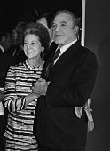 Gene Kelly guest of honour at a Variety Club lunch. With ballerina and a choreographer Alicia Markova London 1980 - NLA - 1980,1980s,ACE,Alicia Marakova,Arts,celebrities,celebrity,Culture,FEMALE,Gene Kelly,holding hands,Leisure,LFL,LIFE,Lifestyle,London,male,man,men,PEOPLE,person,persons,RECREATION,RECREATIONAL,Variety C