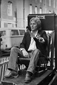 Singer Adam Faith promoting the vehicle seat belt, London, 1980. He was seriously injured in a car crash in 1973. A law making seat belts compulsory was introduced in January 1983 - NLA - 1980,1980s,accident,accidental,accidents,Adam Faith,AUTO,AUTOMOBILE,AUTOMOBILES,AUTOMOTIVE,car,car crash,cars,cities,City,compulsory,crash,crashed,DIA,incident,incidents,injured,INJURIES,injury,law,Lo