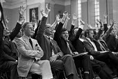 Hospital Consultants meeting to continue private practice and set up an alternative to NHS, London 1974. They passed a motion to extend the provision of private beds and a vote of no confidence in Bar... - NLA - 1970s,1974,activist,activists,Asian,Asians,BAME,BAMEs,BEMM,BEMMS,Black,Black and White,BME,bmes,CAMPAIGNING,CAMPAIGNS,cities,City,Consultant,Consultants,democracy,DEMONSTRATING,Demonstration,dispute,d