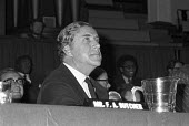 Tiny Rowland at Lonrho shareholders meeting, London, 1973. Edward Heath described Lonrho as The unacceptbale face of capitalism - Peter Arkell - 1970s,1973,capitalism,capitalist,EBF,Economic,Economy,London,Lonrho,male,man,meeting,MEETINGS,men,people,person,persons,Roland,Tiny Rowland