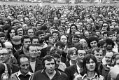 Mass meeting of Chrysler workers, Stoke plant, Coventry, 1973 where the vote was split between those for and against strike action in support of electricians who were already on strike - Peter Arkell - 1970s,1973,AUEW,Chrysler,disputes,electricians,industrial dispute,male,man,Mass,mass meeting,mass meetings,meeting,MEETINGS,member,member members,members,men,people,person,persons,plant,plants,Rootes,