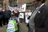 Parents of children with disabilities lobbying Coventry Labour Council against cuts to, and charges for, school transport, Coventry. Lcbour Councillor Kevin Maton arguing with a protestor. The Council... - John Harris - 10-10-2017