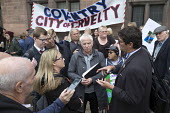 Parents of children with disabilities lobbying Coventry Labour Council against cuts to, and charges for, school transport, Coventry. Lcbour Councillor Kevin Maton arguing with a protestor. The Council... - John Harris - 2010s,2017,activist,activists,adult,adults,against,anger,angry,argue,arguing,argument,Austerity Cuts,buyer,buyers,buying,campaign,campaigning,CAMPAIGNS,child,CHILDHOOD,children,cities,City,communicati