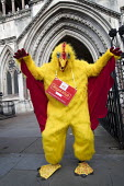 CWU protest against legal challenge by Royal Mail over a strike, Royal Courts of Justice, London - Jess Hurd - 2010s,2017,activist,activists,against,anti union law,Anti Union laws,CAMPAIGNING,CAMPAIGNS,challenge,chicken,chickens,costume,costumes,CWU,DEMONSTRATING,demonstration,dispute,disputes,dressed up,dress