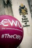 CWU protest against legal challenge by Royal Mail over a strike, Royal Courts of Justice, London - Jess Hurd - 2010s,2017,activist,activists,against,anti union law,Anti Union laws,balloon,balloons,CAMPAIGNING,CAMPAIGNS,challenge,court,court case,courts,CWU,DEMONSTRATING,demonstration,dispute,disputes,Industria