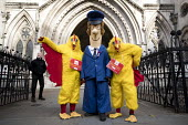CWU protest against legal challenge by Royal Mail over a strike, Royal Courts of Justice, London. Postman Pat and chickens - Jess Hurd - 2010s,2017,activist,activists,against,anti union law,Anti Union laws,CAMPAIGNING,CAMPAIGNS,challenge,chicken,chickens,costume,costumes,court,court case,courts,CWU,DEMONSTRATING,demonstration,dispute,d