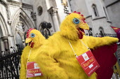 CWU protest against legal challenge by Royal Mail over a strike, Royal Courts of Justice, London - Jess Hurd - 2010s,2017,activist,activists,against,anti union law,Anti Union laws,CAMPAIGNING,CAMPAIGNS,challenge,chicken,chickens,costume,costumes,court,court case,courts,CWU,DEMONSTRATING,demonstration,dispute,d