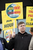 Eddie Dempsey, RMT Justice for Tube Cleaners protest, City Hall, London, against outsourcing on London underground, for sick and holiday pay, travel passes and 10.00 pounds per hour - Jess Hurd - 2010s,2017,activist,activists,against,CAMPAIGNING,CAMPAIGNS,City Hall,cleaner,cleaners,CLEANING,DEMONSTRATING,demonstration,EARNINGS,Eddie Dempsey,holiday pay,Income,inequality,journey,journeys,Justic