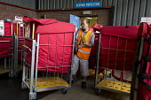 Postal workers, Swansea Mail Centre, South Wales. Revenue protection - John Harris - 2010s,2017,asian,asians,bag,bags,BAME,BAMEs,bays,BEMM,BEMMS,BME,bmes,by hand,cart,carts,chinese,diversity,EBF,Economic,Economy,employee,employees,Employment,ethnicity,job,jobs,LBR,loading bay,Logistic
