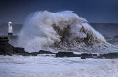 Waves from Storm Ophelia smashing into lighthouse and seawall, Porthcawl, South Wales - Paul Box - 2010s,2017,Atlantic Ocean,CLIMATE,Climate Change,coast,coastal,coasts,conditions,defenses,dusk,ENI,environment,Environmental Issues,EVENING,gale,gale force,gales,Global Warming,harbor,harbors,harbour,