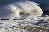 Waves from Storm Ophelia smash into the seafront, lighthouse and seawall, Porthcawl, South Wales - Paul Box - 16-10-2017