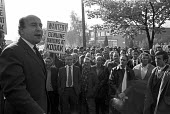 1973 Alan Sapper, ACTT speaking to a mass meeting of Kodak workers, Hemel Hempstead, Hertfordshire, , who organised strikes for union recognition, for a proper union to replace the company union - NLA - 1970s,1973,activist,activists,ACTT,Alan Sapper,CAMPAIGNING,CAMPAIGNS,cities,City,company,company union,DEMONSTRATING,Demonstration,Kodak,male,man,mass,Mass Meeting,mass meetings,meeting,MEETINGS,membe
