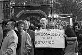 1973 AUEW members protest against the National Industrial Relations Court (NIRC), which had fined the union heavily for defying a court order in conncection with a recognition dispute. Sir Donald Duck... - NLA - 1970s,1973,activist,activists,against,anti union legislation,AUEW,banner,banners,CAMPAIGNING,CAMPAIGNS,Court,DEMONSTRATING,Demonstration,Industrial Relations Act 1971,laws,male,man,member,member membe