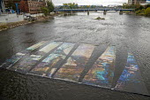 Grand Rapids, Michigan, USA, ArtPrize competition OilWater by Ryan Spencer Reed, a photograph colored to look like an oil slick in the Grand River, it was taken during the Dakota Access Pipeline prote... - Jim West - 2010s,2017,Access,ACE,activist,activists,America,american,americans,Amerindian,Amerindians,art,art festival,Art Gallery,Art Prize,ArtPrize,arts,artwork,artworks,BAME,BAMEs,BME,bmes,CAMPAIGNING,CAMPAIG