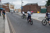 Cyclists Erith High Street, Bexley, London - Philip Wolmuth - 2010s,2017,adolescence,adolescent,adolescents,bicycle,bicycles,BICYCLING,Bicyclist,Bicyclists,bike,bikes,CHILD,CHILDHOOD,children,cities,City,cycle,cycles,cycling,Cyclist,cyclists,development,highway,