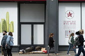 Homeless man sleeping in doorway of closed Pret a Manger store, Oxford Street, London. So broke it hurts - Philip Wolmuth - 2010s,2017,asleep,beg,beggar,beggars,BEGGER,begging,begs,bought,buying,cities,City,close,closed,closing,closure,closures,coffee shop,commodities,commodity,consumer,consumers,customer,customers,doorway