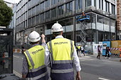 Workers employed by Australian contractor Multiplex, construction site, Oxford Street, London - Philip Wolmuth - construction workers, work,2010s,2017,boss,bosses,bought,Brownfield Site,building,building site,Building Worker,building workers,buildings,buying,cities,City,commodities,commodity,communicating,commun