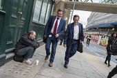 Office workers walking past a homeless man begging in the street, London Bridge business district - Philip Wolmuth - 04-10-2017