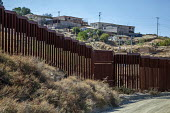 Tecate, California, USA US Mexican border wall - David Bacon - 2010s,2017,american,americans,border,border control,border controls,borders,California,country,countryside,desert,Diaspora,fence,foreign,IMMIGRANT,IMMIGRANTS,immigration,latinamerica,metal,MEX484,Mexi