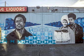 Oakland, California, USA, Artists painting the Black Panther Mural on the wall of a liquor store, celebrating the history of the Black Panther Party. The mural is a portrait of Huey P. Newton, party c... - David Bacon - African Americans,2010s,2017,ACE,adult,adults,African,African American,American,americans,art,artist,artists,arts,artwork,artworks,BAME,BAMEs,Black,Black Panther,Black Panthers,BME,bmes,BPP,California