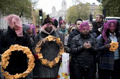 LGSM protest Rememberance Day laying wreaths at the Cenotaph representing the 17 migrants who have died everyday in 2017. Whitehall, London. Lesbian and Gays Support the Migrants - Jess Hurd - 2010s,2017,activist,activists,BAME,BAMEs,Black,BME,bmes,CAMPAIGNING,CAMPAIGNS,Cenotaph,death,deaths,DEMONSTRATING,Demonstration,Diaspora,died,diversity,equal,ethnic,ethnicity,FEMALE,floral tribute,flo