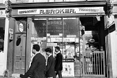 Young men passing a closed newsagents shop in west London in the summer of 1968 - Patrick Eagar - 24-06-1968