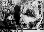 Artist Marc Chagall painting in his studio, Vence, France 1961 - Felix H. Man - 1960s,1961,ACE art,art,artist,artists,artwork,artworks,brush,brushes,culture,France,french,male,man,Marc Chagall,men,modern,modernism,modernist,modernists,painter,painters,painting,paintings,people,pe