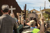 Nogales, Arizona USA Protest on both sides of the USA Mexican border fence for migrants who have died trying to cross the border. US Border Patrol officers watch from the top of the hill. The rally wa... - Jim West - 12-11-2017
