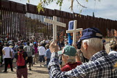 Nogales, Arizona USA Protest on both sides of the U.S. Mexican border fence for migrants who have died trying to cross the border. The rally was organized by the School of the Americas Watch, a group... - Jim West - 2010s,2017,activist,activists,America,Arizona,Belief,border,border fence,border wall,CAMPAIGNING,CAMPAIGNS,christian,christianity,christians,conviction,cross,crosses,crucifix,death,deaths,DEMONSTRATIN