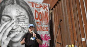 Nogales, Sonora Mexico Father Roy Bourgeois speaking, protest at the U.S. Mexican border fence to remember migrants who have died trying to cross the border. Farther Bourgois is the founder of the Sch... - Jim West - 2010s,2017,activist,activists,banner,banners,border,border fence,border wall,CAMPAIGNING,CAMPAIGNS,Catholic,death,DEATHS,DEMONSTRATING,demonstration,Diaspora,died,Father,Father Roy Bourgeois,FATHERS,f