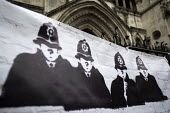 Protest against Police anonymity at The Public Inquiry into Undercover Policing, Royal Courts of Justice, London. The Campaign Opposing Police Surveillance publicises and supports the quest for justic... - Jess Hurd - 20-11-2017