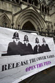 Protest against Police anonymity at The Public Inquiry into Undercover Policing, Royal Courts of Justice, London. The Campaign Opposing Police Surveillance publicises and supports the quest for justic... - Jess Hurd - 2010s,2017,activist,activists,adult,adults,against,anonymity,banner,banners,campaign,campaigner,campaigners,campaigning,CAMPAIGNS,court,court case,courts,covert,DEMONSTRATING,demonstration,DEMONSTRATI