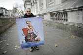 Artist Kaya Mar with Philip Hammond painting, Downing Street, 2017 Budget Day, Westminster, London - Jess Hurd - 11,2010s,2017,ACE,activist,activists,art,Artist,artists,arts,artwork,artworks,Brexit,Budget,CAMPAIGNING,CAMPAIGNS,Chancellor Philip Hammond,CONSERVATIVE,Conservative Party,conservatives,culture,DEMONS