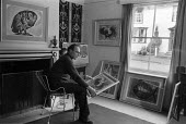 Michael Rothenstein Great Bardfield Artist at home 1958. Rothenstein is holding a linocut entitled Cockerel Turning Round also seen on the wall to his left. The Great Bardfield Artists were a communit... - Alan Vines - 03-07-1958