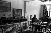 Edward Bawden Great Bardfield Artist 1958. To his right on the floor is his lithograph entitled Brighton Pier. The Great Bardfield Artists were a community of artists who lived in Great Bardfield, a v... - Alan Vines - 03-07-1958