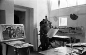 Michael Rothenstein Great Bardfield Artist 1958. On his right his linocut entitled Still LIfe with Landscape. The Great Bardfield Artists were a community of artists who lived in Great Bardfield, a vi... - Alan Vines - 03-07-1958