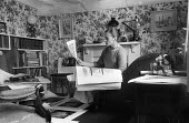 Sheila Robinson Great Bardfield Artist with some of her artworks 1958. The Great Bardfield Artists were a community of artists who lived in Great Bardfield, a village in north west Essex. They lived t... - Alan Vines - 03-07-1958