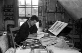 Audrey Cruddas artist and Great Bardfield Artists School member 1958 working in her home studio, Great Bardfield. The Great Bardfield Artists were a community of artists who lived in Great Bardfield,... - Alan Vines - 03-07-1958
