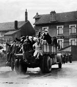 Belgians fleeing the Nazi invasion northern Belgium May 1940. Waving goodbye from the back of an open truck - Report Archive - 11-05-1940