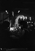 Caricatures of Conservative Harold MacMillan, satirical comedy at The Establishment London Soho 1961. The Establishment Club was created by Peter Cook and Nicholas Luard in Greek Street in the West En... - Romano Cagnoni - 17-11-1961