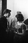 Comedian and satirist Peter Cook with a friend at The Establishment London Soho 1961. The Establishment Club was created by Peter Cook and Nicholas Luard in Greek Street in the West End of London with... - Romano Cagnoni - 20-10-1961