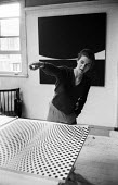 Bridget Riley in her studio, Chelsea, London, 1963, discussing a painting called Fission - Romano Cagnoni - 1960s,1963,ACE,art,artist,artists,arts,artwork,artworks,Bridget Riley,communicating,communication,conversation,conversations,creativity,culture,dialogue,discourse,discuss,discusses,discussing,discussi