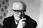 Labour Peer Lord Fenner Brockway 1965 founder and chairman of Movement for Colonial Freedom - Romano Cagnoni - 1960s,1965,Fenner Brockway,Freedom,Labour Party,London,Lord,LORDS,male,man,men,Movement,people,person,persons,pipe,PIPES,POL,political,POLITICIAN,POLITICIANS,Politics,SMOKE,smoker,smokers,smoking